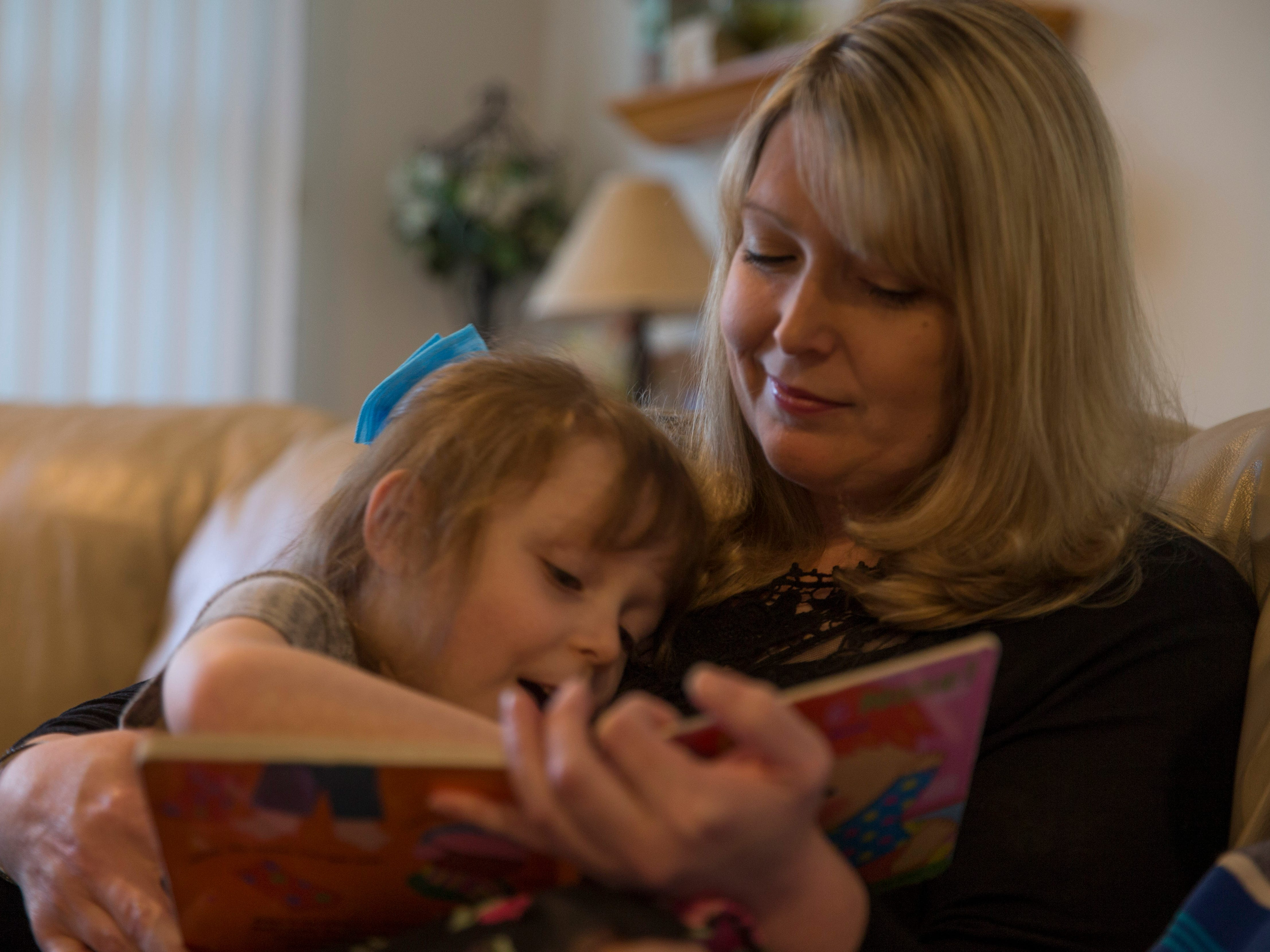 Amie Cottrell reads a book with her daughter Katelyn, 4. Jackson native Amie Cottrell is a 39-year-old mother of four young children that is battling Stage 4 breast cancer. She shares her story about managing motherhood despite the advanced cancer. Jackson, NJTuesday, May 7, 2019