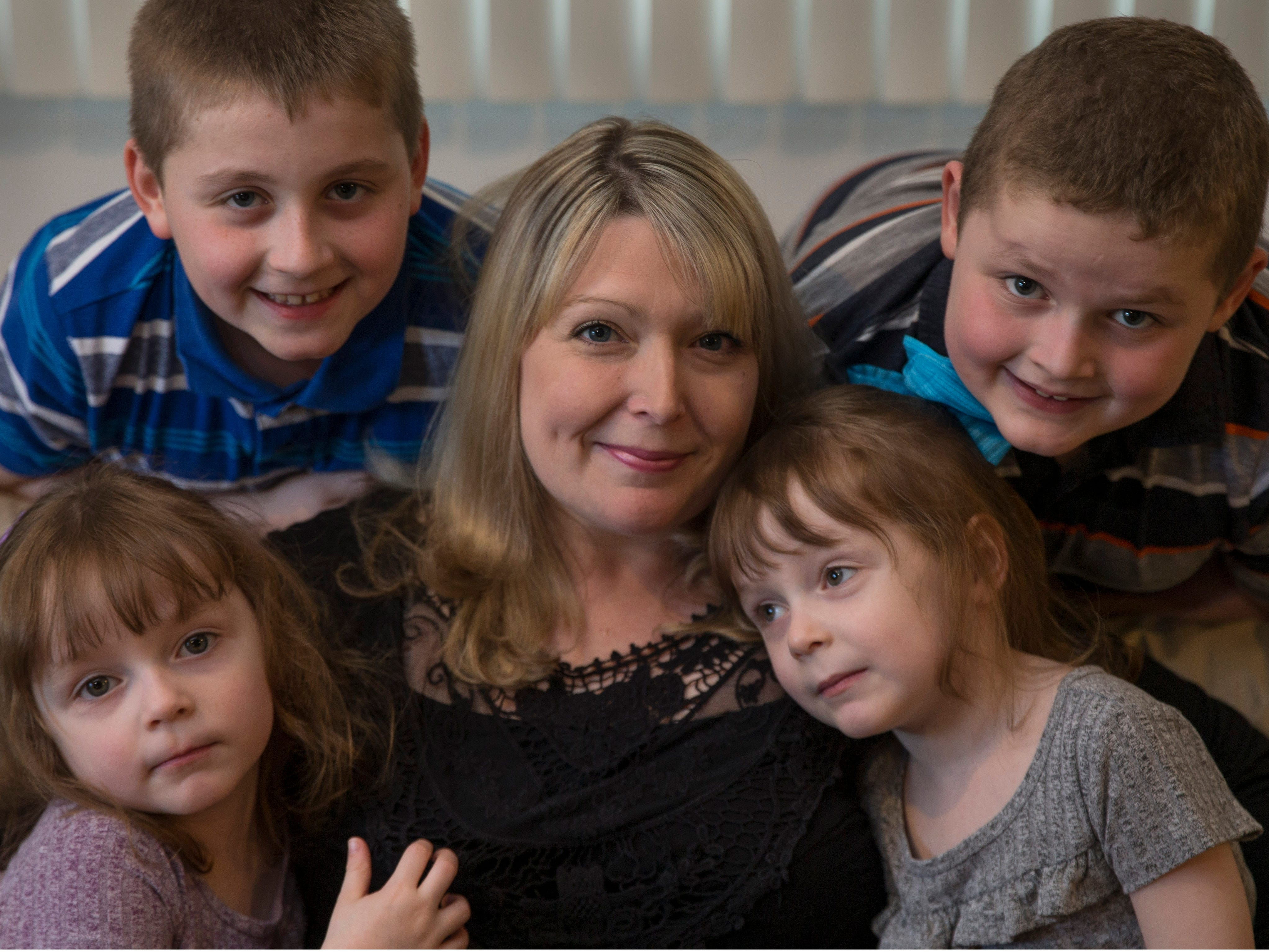 Amie Cottrell surrounded by her four children, clockwise from top left, Nicholas, 9, Michael, 7, Katelyn, 4, and Alyssa, 4. Jackson native Amie Cottrell is a 39-year-old mother of four young children that is battling Stage 4 breast cancer. She shares her story about managing motherhood despite the advanced cancer. Jackson, NJTuesday, May 7, 2019