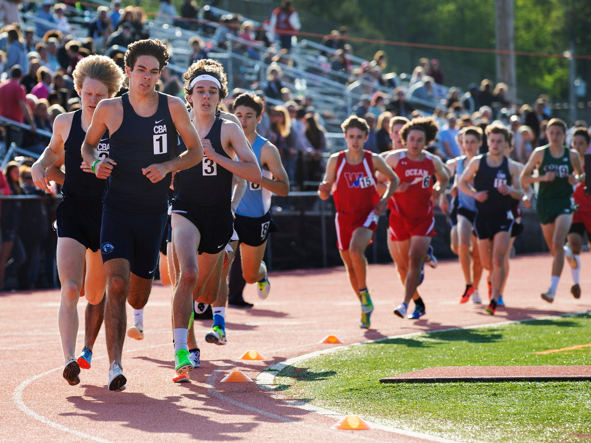 Tim McInerney, CBA, leads the pack on third lap of the Boys 1600 at the Monmouth County Track Championship in Middletown on May 8, 2019