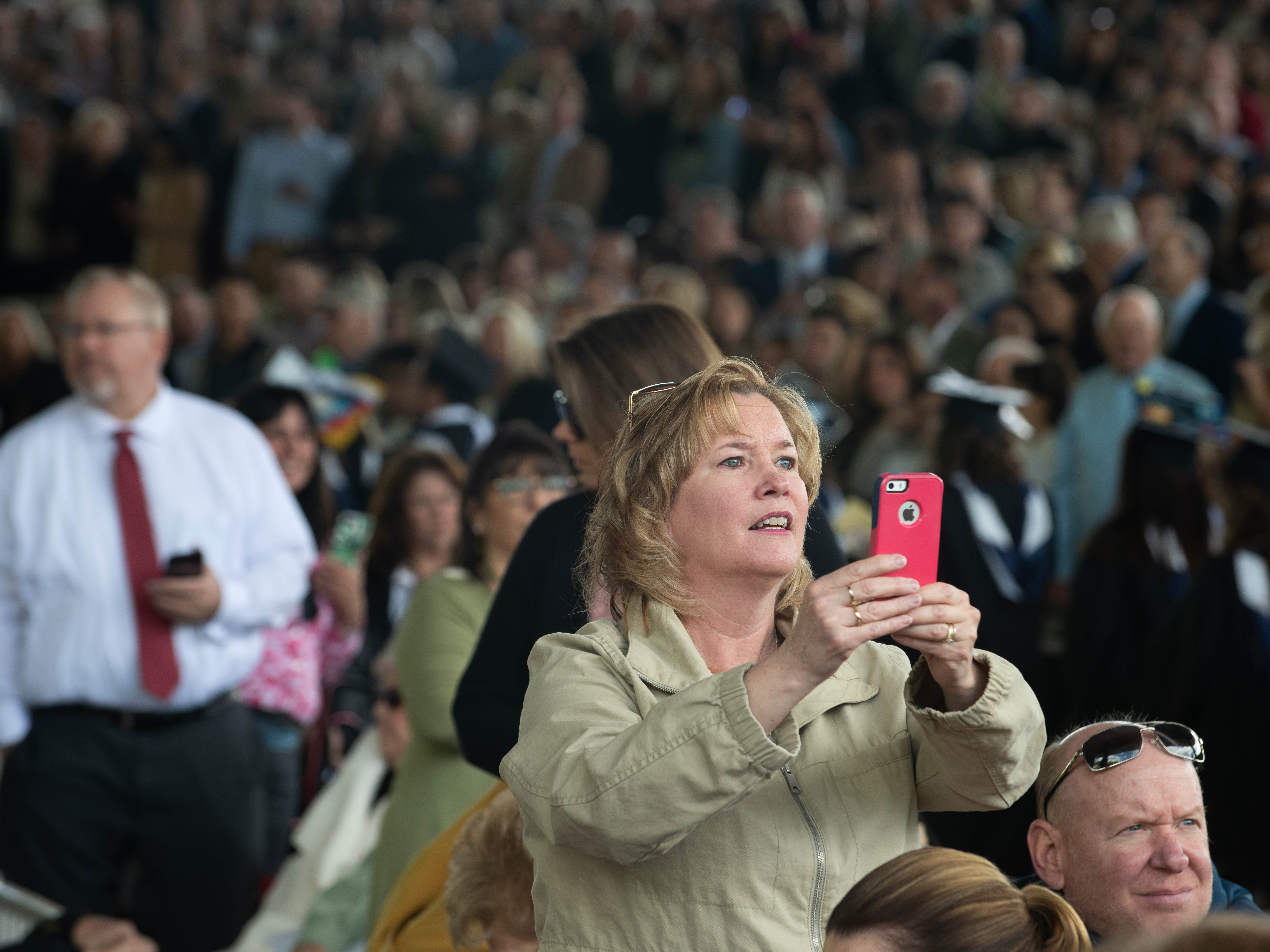 Mary Ellen Mircovich of Howell looks for her graduating son, Thomas, at the Monmouth University undergraduate commencement for the class of 2019 at PNC Bank Arts Center, Holmdel, on May 15, 2019.