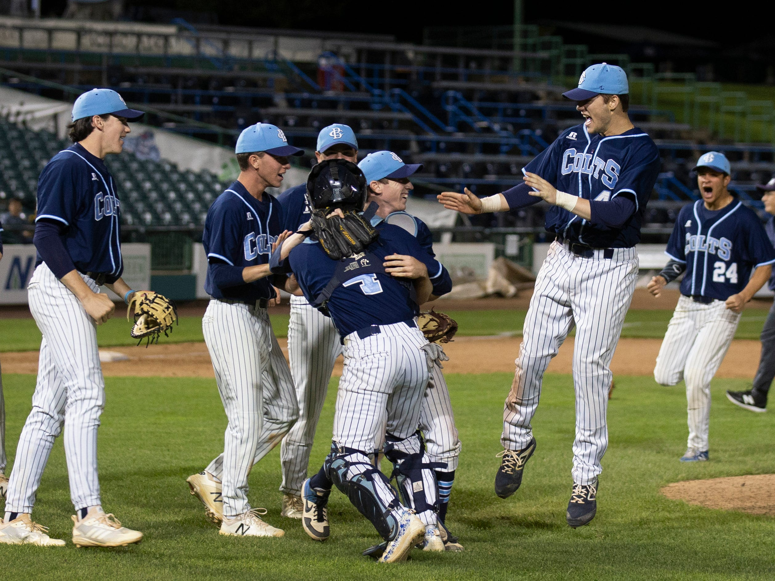 CBA players charge the mound as they celebrate their Monmouth County title. Christian Brothers Academy dominates Ocean Township in Monmouth County Baseball Final in Lakewood on May 7, 2019,