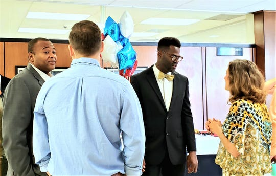 Mayor Anthony Williams (left) and Travis Craver (center) talk to those who attended Craver's swearing-in ceremony Wednesday morning. Craver was sworn in to the Abilene City Council's Place 6 position.