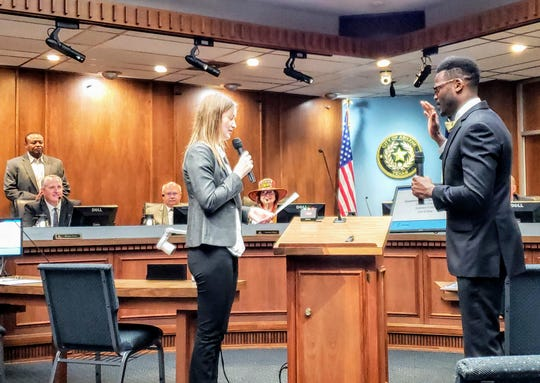 Shawna Atkinson, interim city secretary, gives Travis Craver his oath of office Wednesday. Craver was sworn in to Place 6 on the Abilene City Council.