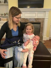 Krista Madden with her daughters Treya, 2, and newborn Shaylie.