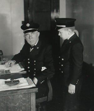 """In 1923, when James """"Red"""" Hoyle (pictured, right) was nine, he sold the State edition of the Asheville Citizen Times"""