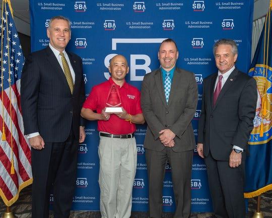 Chuck Dong of Shortstop Deli receives his award
