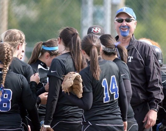 Former Olympic softball coach Dusty Anchors, with a painted blue goatee during a Trojans' playoff game in 2011, died Wednesday after complications from heart failure. Anchors coached Olympic for seven seasons before taking over Ridgefield High School's softball program.