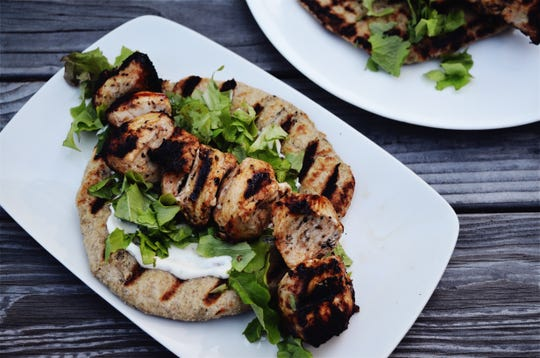 The herbed chicken is marinated for a half-hour before heading for the grill.