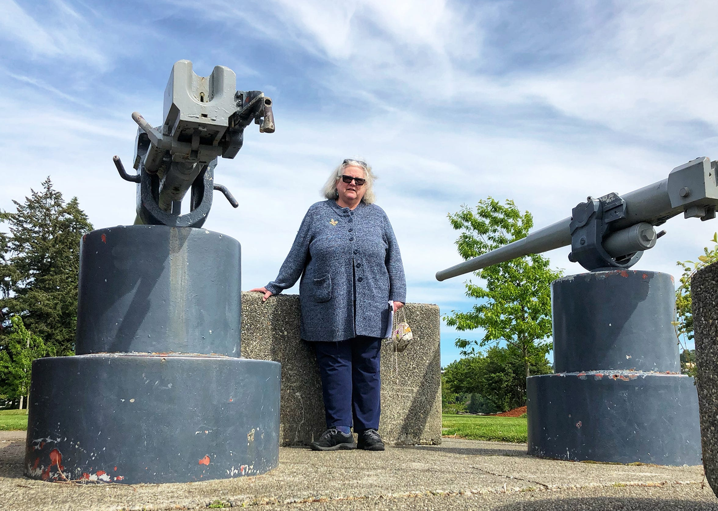 Elisabeth Demmon stands within a World War I memorial she's been studying since 2017.