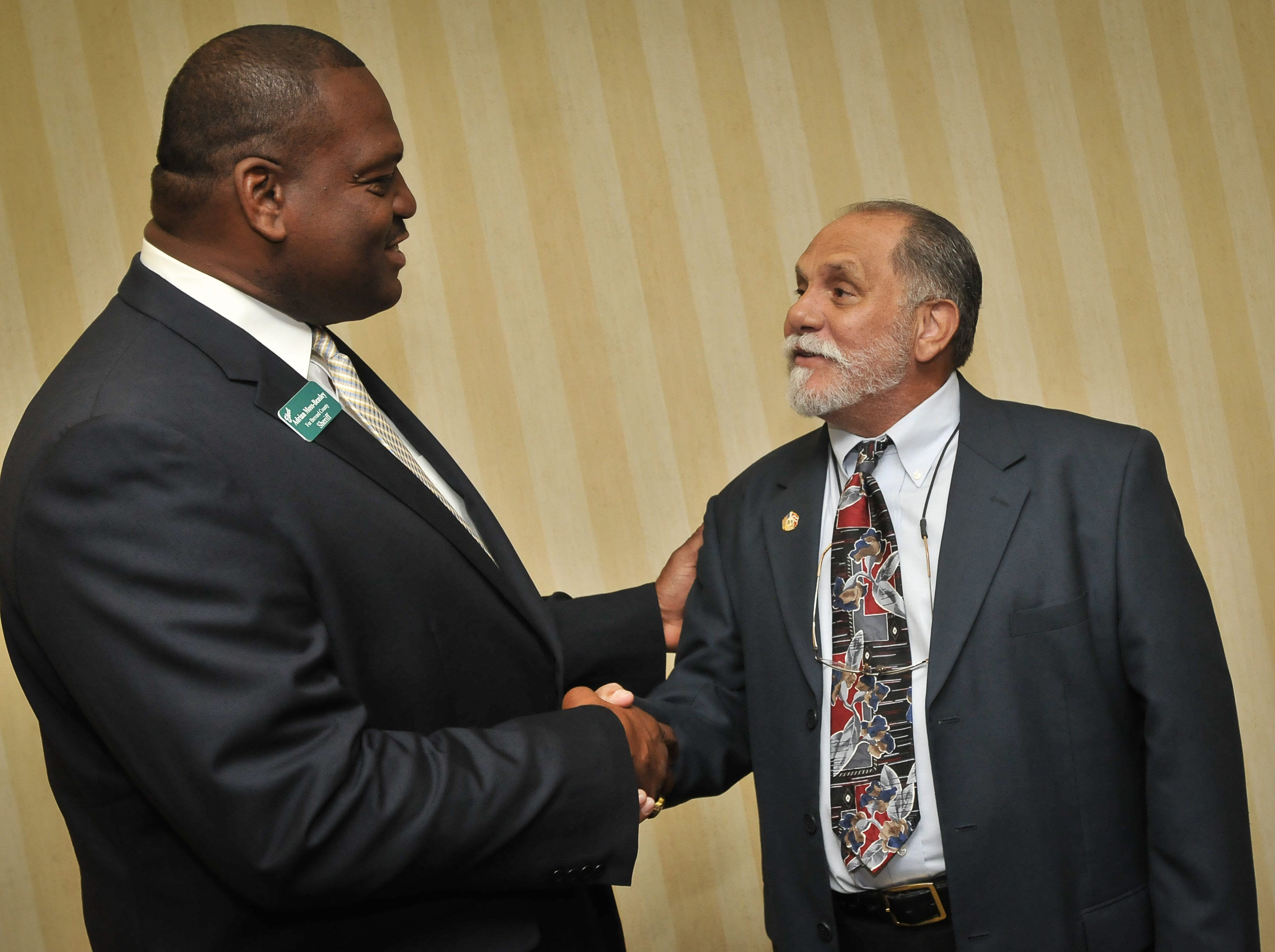 Adrian Moss-Beasley talks with Samuel Lopez during the Puerto Rican Day banquet dinner at the Hilton Rialto.