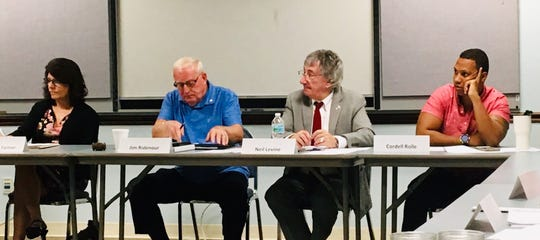 Listening to the Brevard Cultural Alliance board discussion on Wednesday are, from left, Treasurer Andrea Farmer, Chairman Jim Ridenour, Executive Director Neil Levine and board member  Cordell Rolle.