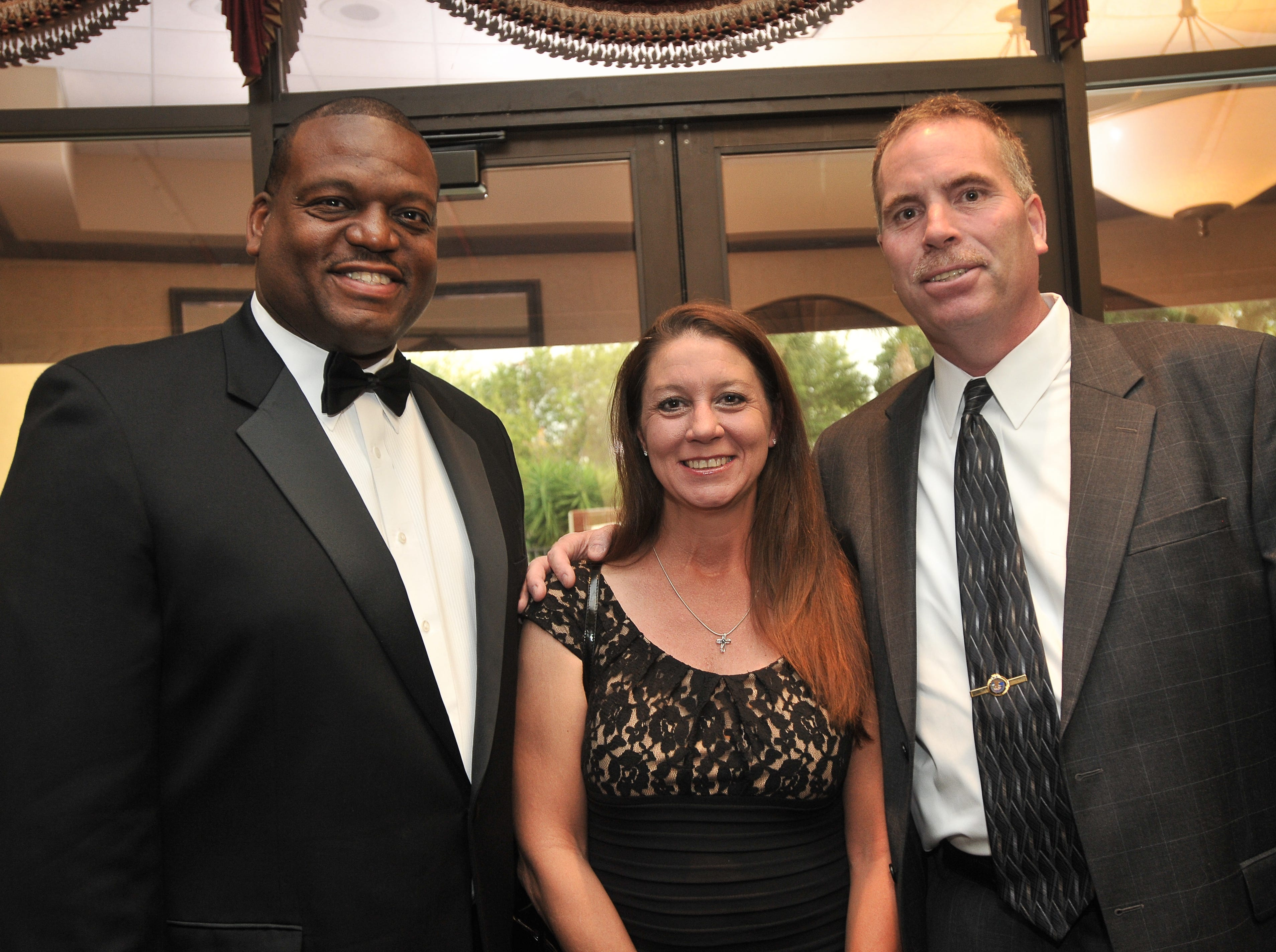 Adrian Moss-Beasley, Vanessa Brewer and John Lau pose together during Focus on the Factors, the annual fundraising event for National Veterans Homeless Support, at the Holiday Inn Viera.