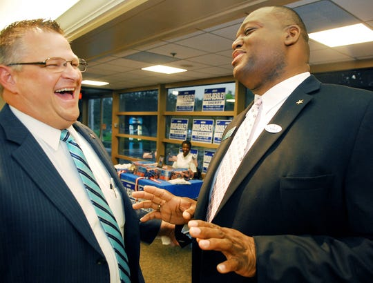 Sheriff candidates Wayne Ivey, left, and Adrian Moss-Beasley joke with each other at a Political Hobnob, when they ran against each other in 2012.