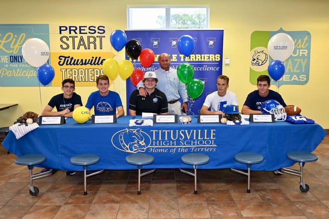 Jackson Woodward (second from right) signed out of Titusville High on May 14, 2019.