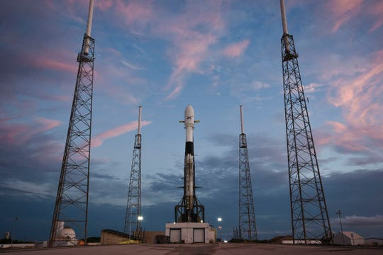 A SpaceX Falcon 9 rocket sits on the pad at Cape Canaveral Air Force Station's Launch Complex 40 with 60 Starlink satellites on Tuesday, May 14, 2019.