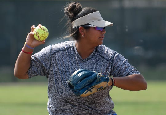Anastasia Leibas throws the ball to first base during practice, Tuesday, May 12, 2019, in Kingsville.