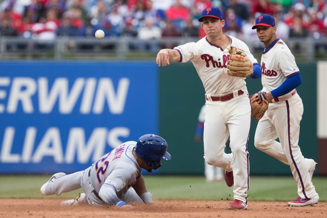 Apr 17, 2019; Philadelphia, PA, USA; Philadelphia Phillies second baseman Scott Kingery (4) throws to first base for a double play after tagging out New York Mets first baseman Dominic Smith (22) during the eighth inning at Citizens Bank Park. Mandatory Credit: Bill Streicher-USA TODAY Sports