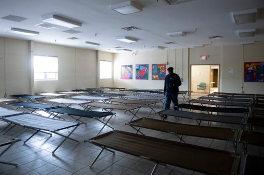 Intake Supervisor Ernest 'Radio' Lindsay walks past rows of cots inside Joseph's House in Camden, N.J. Tuesday, May 14, 2019.