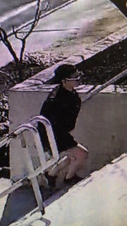 Police released surveillance photos in hopes of identifying the suspect who stole from an altar server during a Sunday Mass at St. Charles Borromeo Church in Washington Township.
