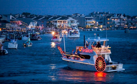 The Night in Venice boat parade in Ocean City passes by decorated homes on the bayfront every year. This year's event is July 13.