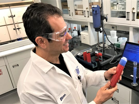 Scientist Elton Menon works on prototype of the next generation of Old Spice deodorant at P&G's Mason Business Center. The facility is the company's largest R&D center in the world.