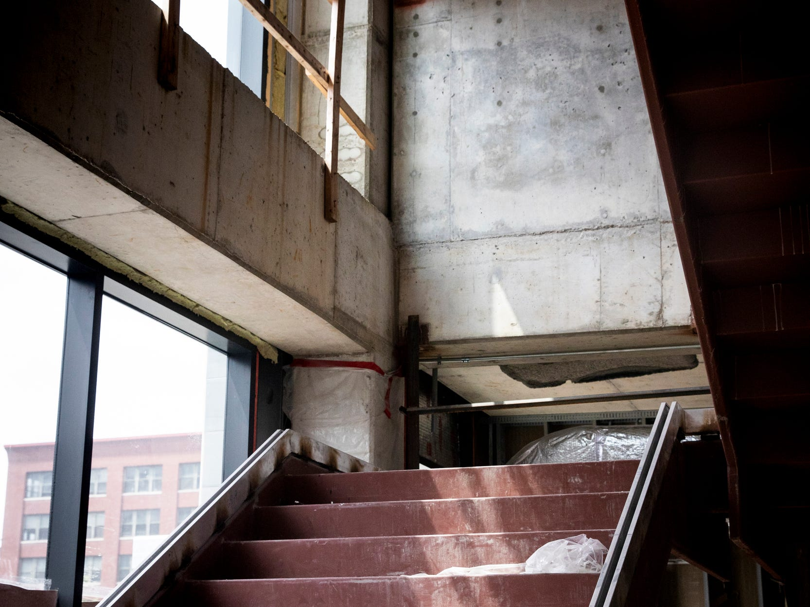 Stairs lead from the Kroger store to the second floor Food Hall.