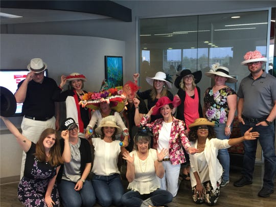 Hats galore at Sibcy Cline on Derby Day