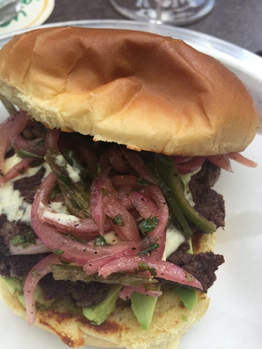 The Delwood burger, with salsa criolla and huancaina sauce, from Delwood in Mount Lookout