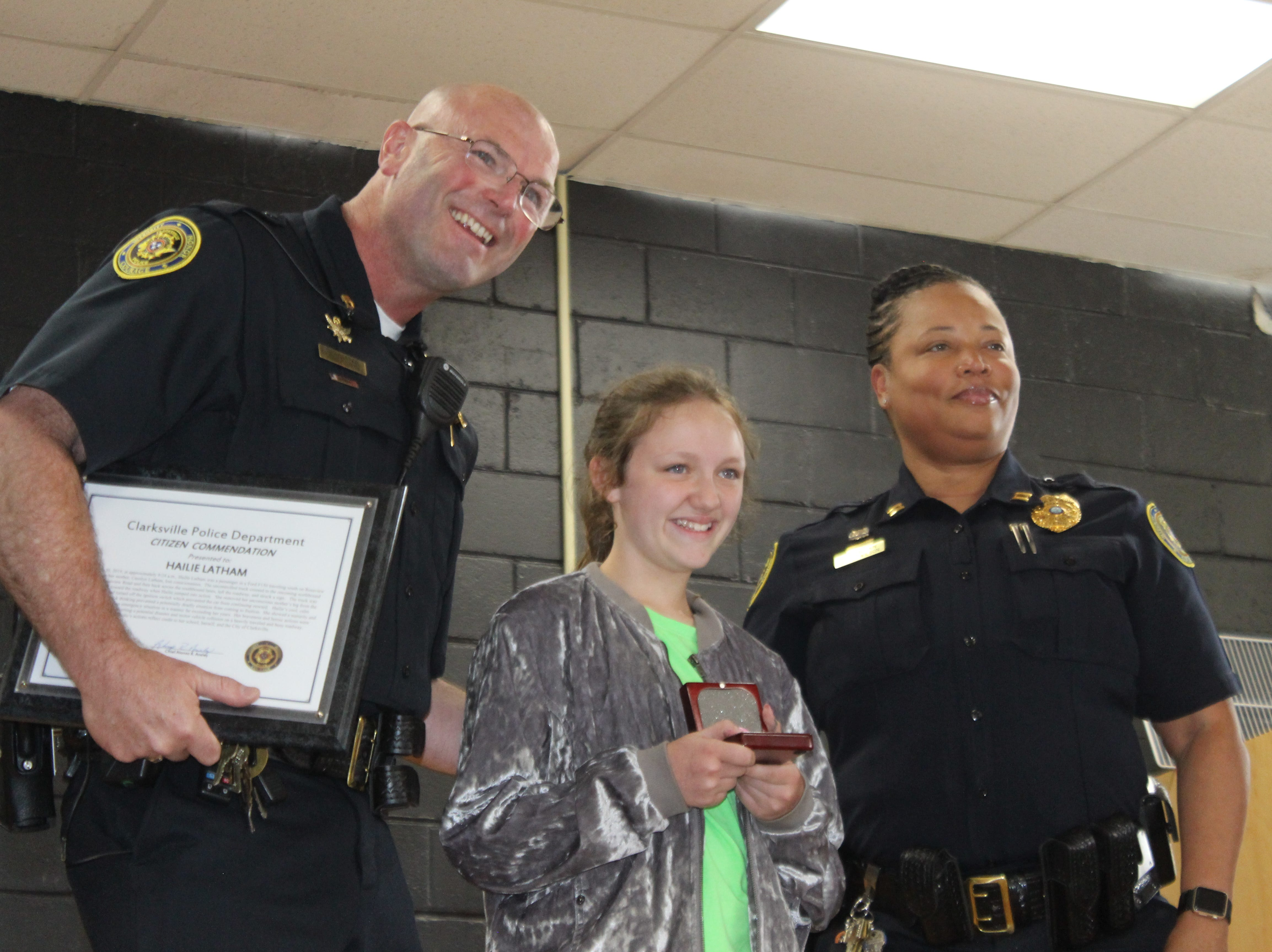 Hailie Latham, a 10-year old fourth grader at Moore Magnet Elementary, receives an award as Clarksville Police honor her for heroism during a ceremony on May 15, 2019.