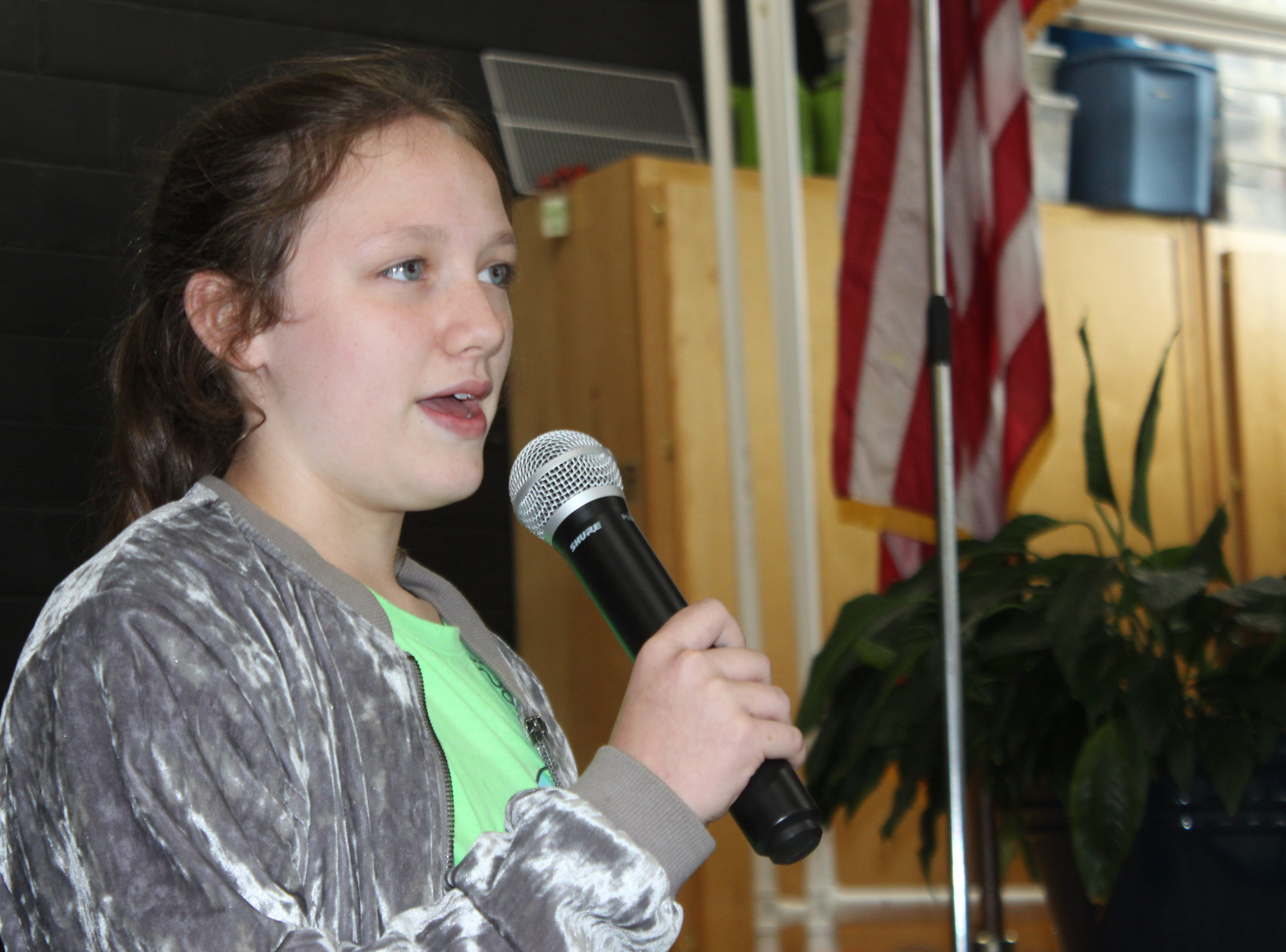 Hailie Latham, a 10-year old fourth grader at Moore Magnet Elementary, speaks to her classmates about the day she saved lives with her quick-thinking actions.