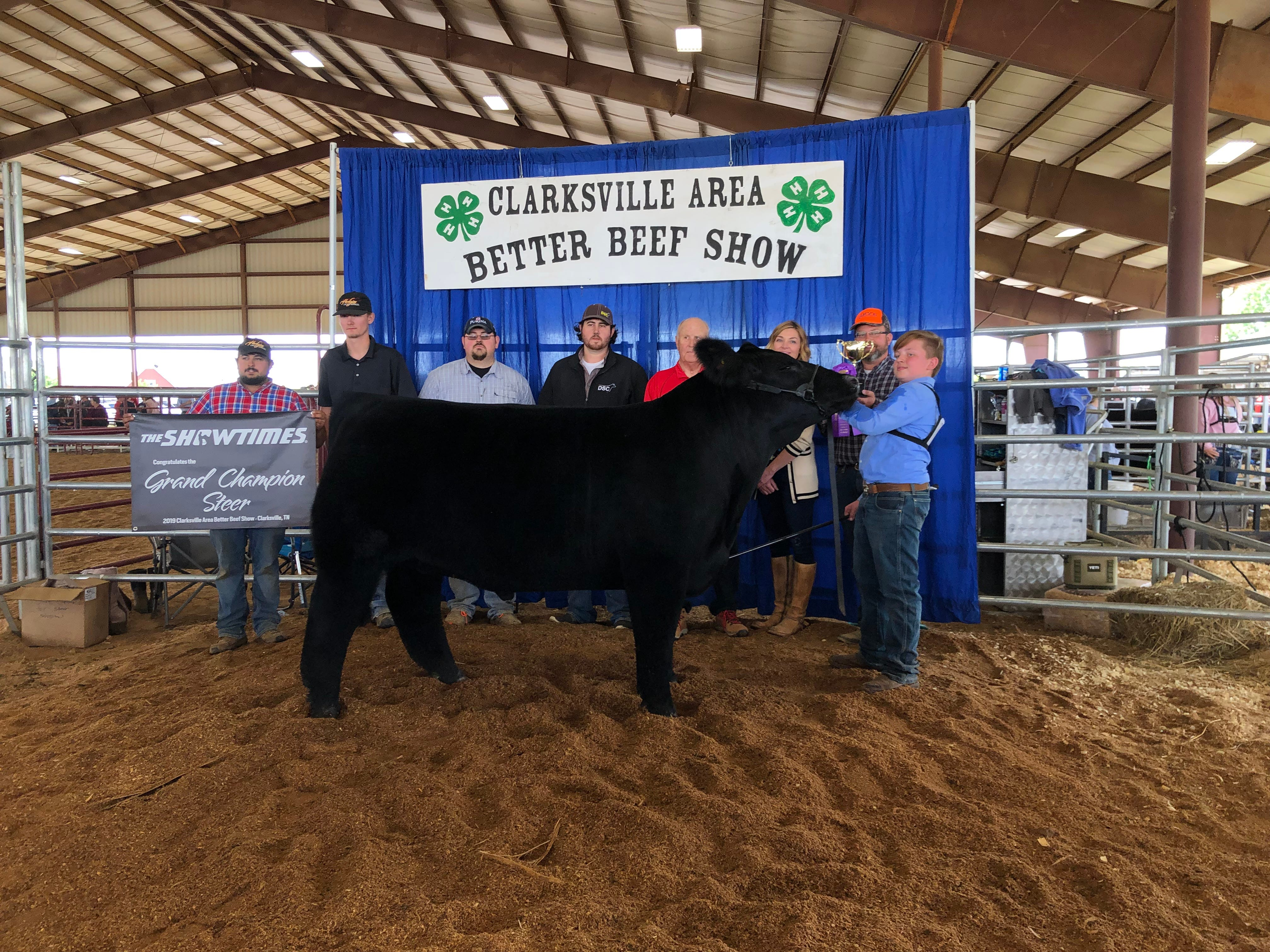 Augustus Rye shows off his Grand Champion steer Boomer.