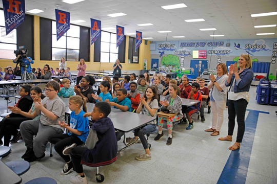Students and teachers at Moore Magnet Elementary applaud fellow fourth grader Hailie Latham, after she was honored by  Clarksville Police for heroism during a ceremony on May 15, 2019.