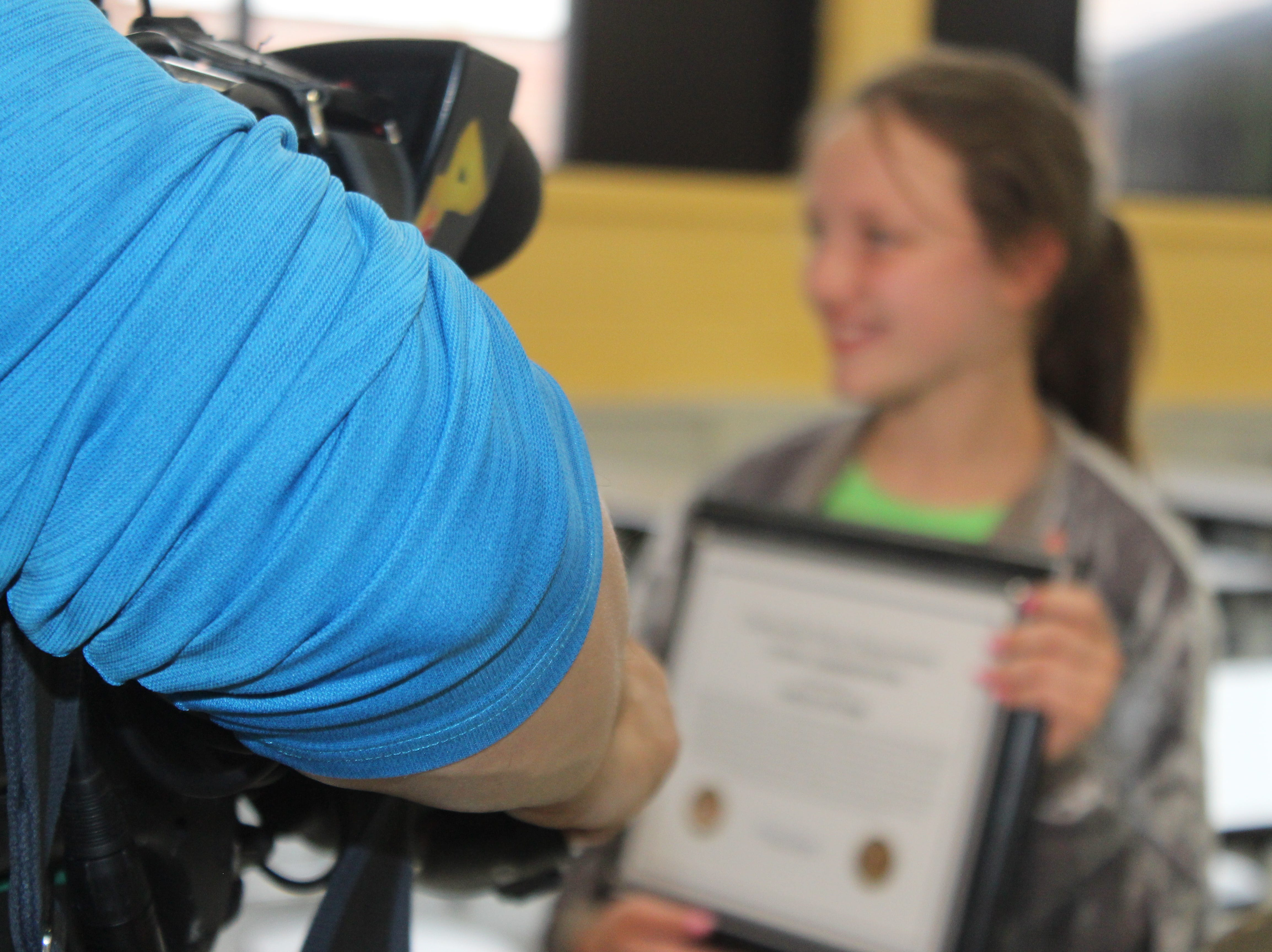 Hailie Latham, a 10-year old fourth grader at Moore Magnet Elementary, shows off her award to the media after Clarksville Police honored her for heroism during a ceremony on May 15, 2019.
