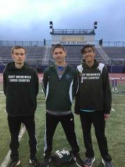 East Brunswick runners Apostolos Maroulis, Nicholas Chartoff and Alex Gultekinoglu after winning the 4x800 at the 2019 GMC Championships.