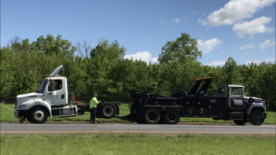 A tow truck and tractor trailer cab at the scene of an accident on Route 22 westbound in Bridgewater.