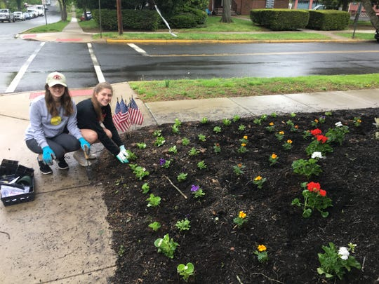 Bound Brook High School Interact Club students working to beautify Bound Brook.