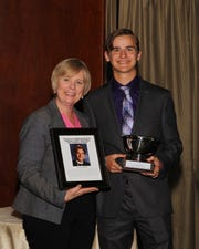 SCVTHS Principal Diane Ziegler (left) and Evan Sapirman pose for a picture during the scholar athlete reception.