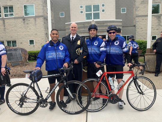 Police unity tour from left to right: Ptl. Mark Constantino, Chief William Parenti, Det. Joe Mazza, nd Det. Al Domizi