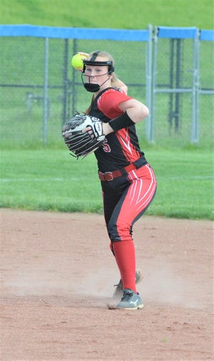 Coshocton shortstop Morgan Bryant makes a throw to first base in the Redskins' loss to Meadowbrook in last year's district semifinal. Bryant will continue her softball career with Marietta College.
