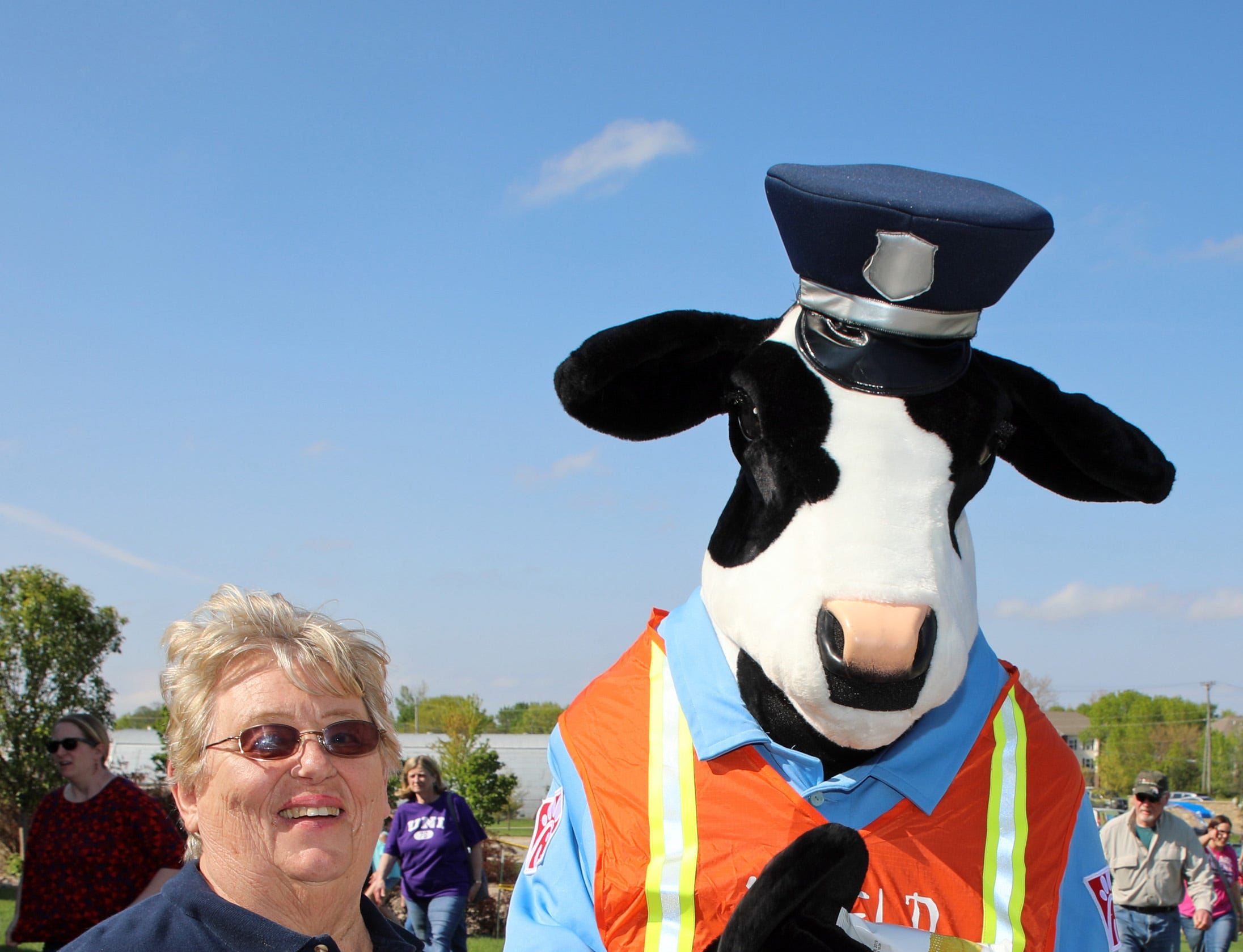 Joan Quinlin of the Ankeny Citizen's Police Academy serves cookies to the cow from Chick Fil-A during the Ankeny Police Week Community Picnic on Tuesday, May 14, 2019 at the Ankeny Police Headquarters located at 411 SW Ordnance Road. The event featured a tour of the police station, magician Jonathon May, free Chick Fil-A sandwiches for the first 1,000 guests, free Kona Ice, temporary tattoos, and a great opportunity to meet the officers who protect and serve the city of Ankeny.