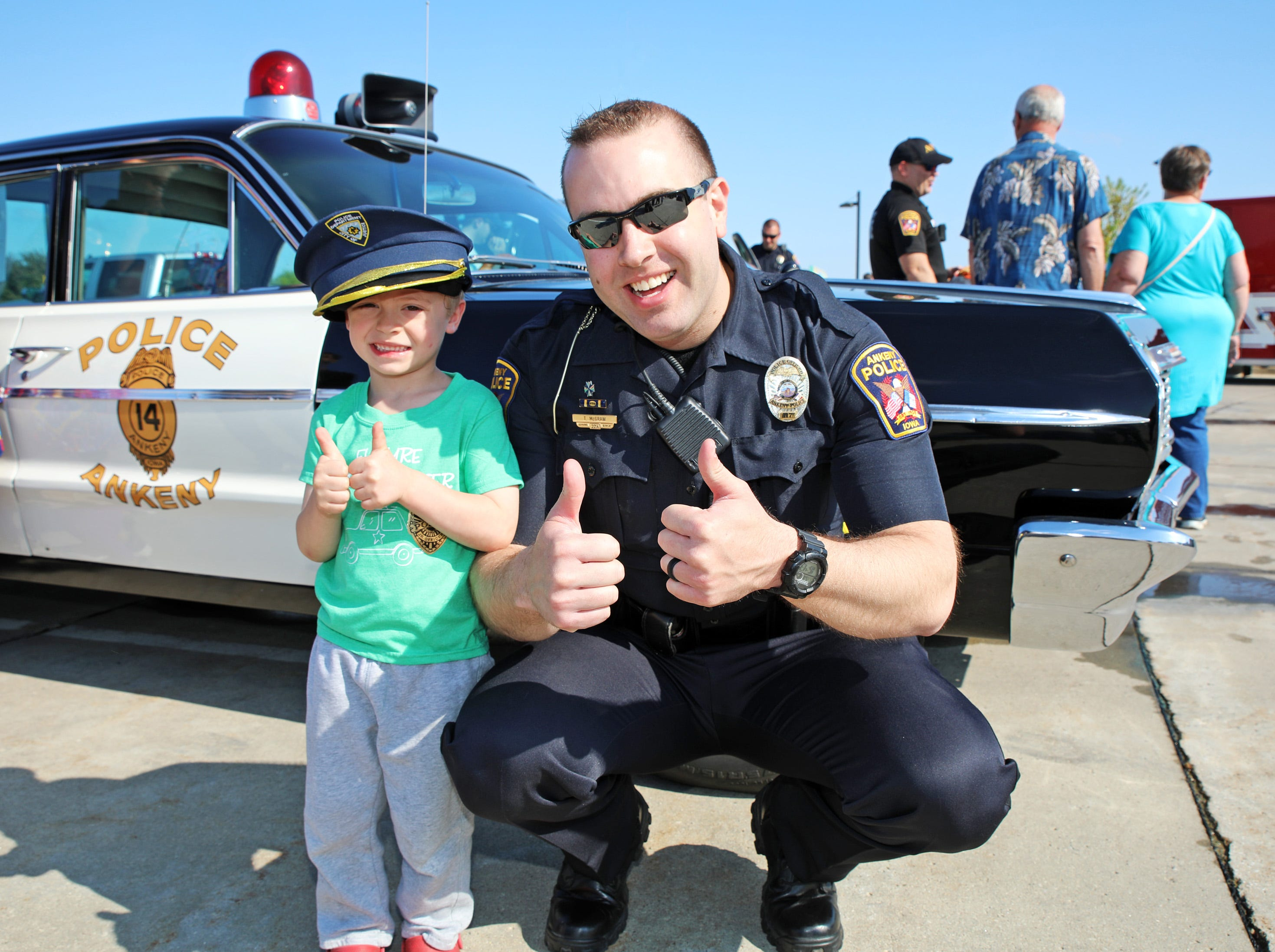 Officer Tyler McGraw of the Ankeny Police Dept. and Ben Miller, 4, of Ankeny enjoy the Ankeny Police Week Community Picnic on Tuesday, May 14, 2019 at the Ankeny Police Headquarters located at 411 SW Ordnance Road. The event featured a tour of the police station, magician Jonathon May, free Chick Fil-A sandwiches for the first 1,000 guests, free Kona Ice, temporary tattoos, and a great opportunity to meet the officers who protect and serve the city of Ankeny.