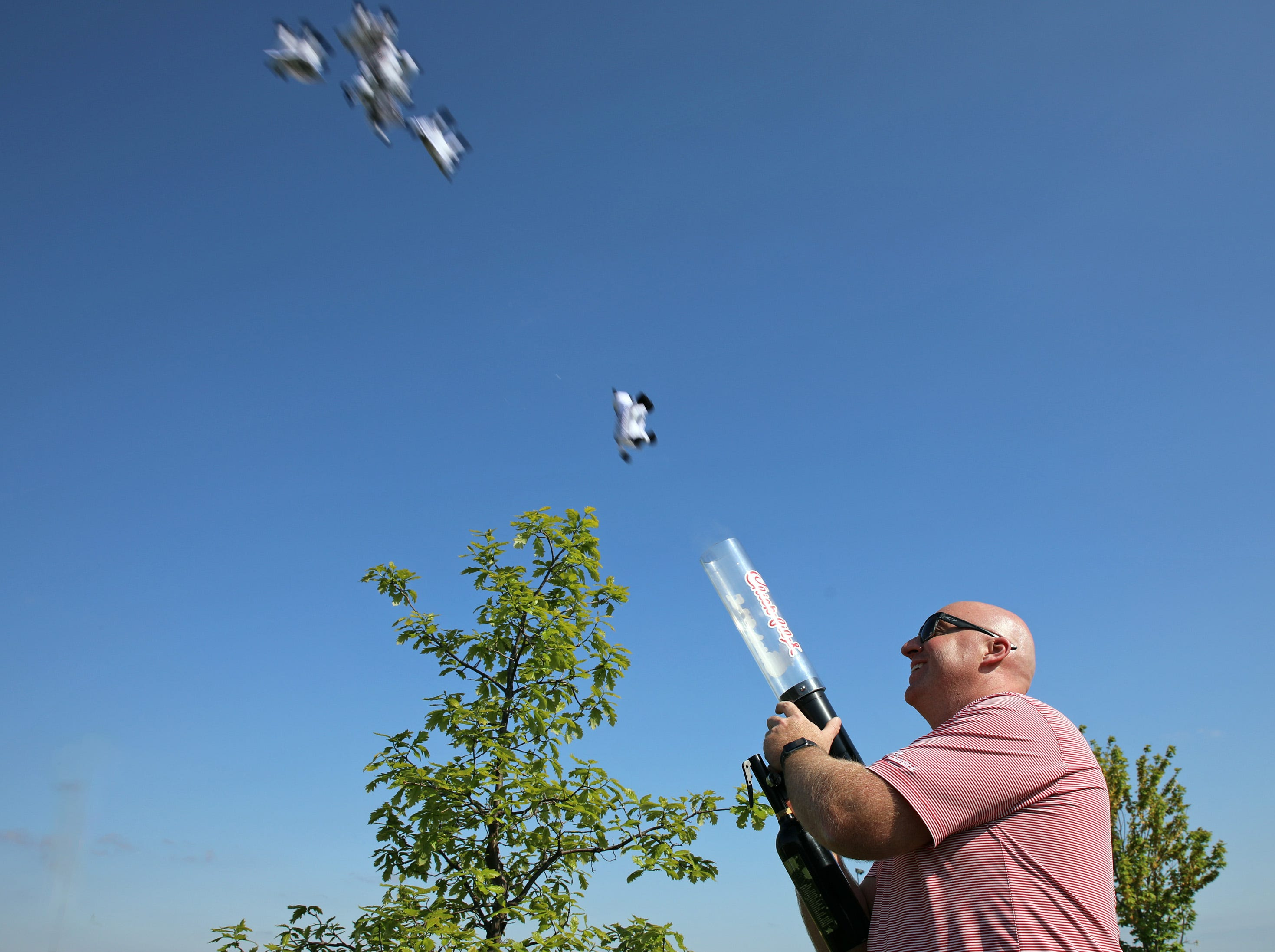 Thomas Krogman from Chick Fil-A shoots toy cows from a cannon for the kids during the Ankeny Police Week Community Picnic on Tuesday, May 14, 2019 at the Ankeny Police Headquarters located at 411 SW Ordnance Road. The event featured a tour of the police station, magician Jonathon May, free Chick Fil-A sandwiches for the first 1,000 guests, free Kona Ice, temporary tattoos, and a great opportunity to meet the officers who protect and serve the city of Ankeny.