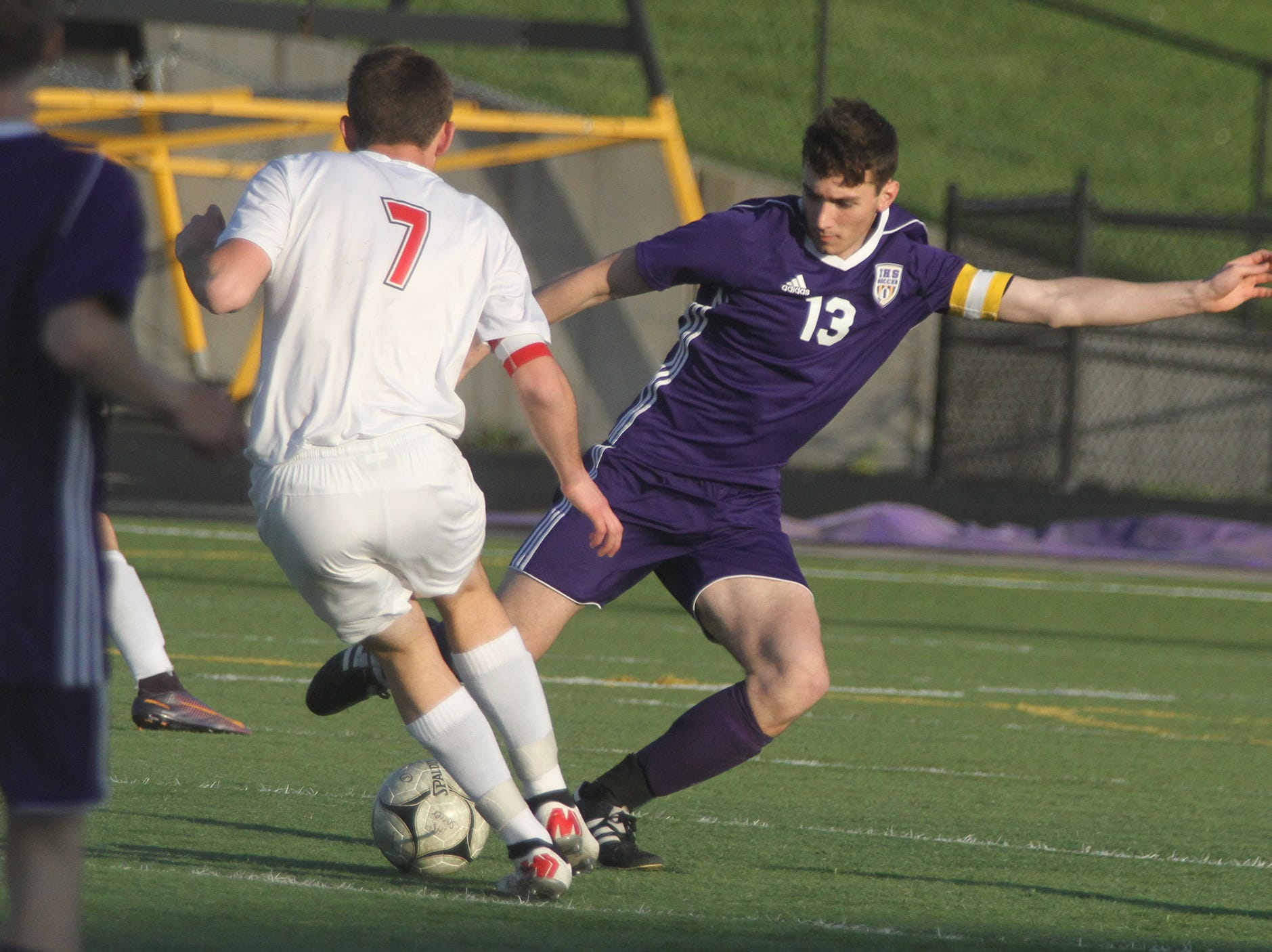 Indianola junior Andreas Miller knocks the ball away from Newton senior Jacob Murphy. Indianola beat Newton 2-0 at home in a Little Hawkeye Conference game.