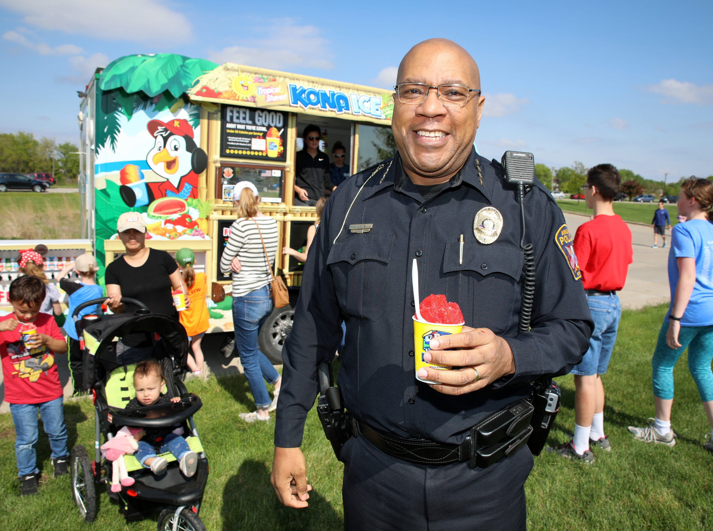 Ankeny Police Chief Darius Potts pulls over at the Kono Ice truck during the Ankeny Police Week Community Picnic on Tuesday, May 14, 2019 at the Ankeny Police Headquarters located at 411 SW Ordnance Road. The event featured a tour of the police station, magician Jonathon May, free Chick Fil-A sandwiches for the first 1,000 guests, free Kona Ice, temporary tattoos, and a great opportunity to meet the officers who protect and serve the city of Ankeny.