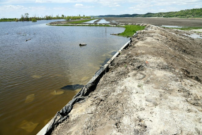 A makeshift levee holds back floodwaters from the Missouri River in Hamburg, Iowa, on Friday, May 10, 2019.