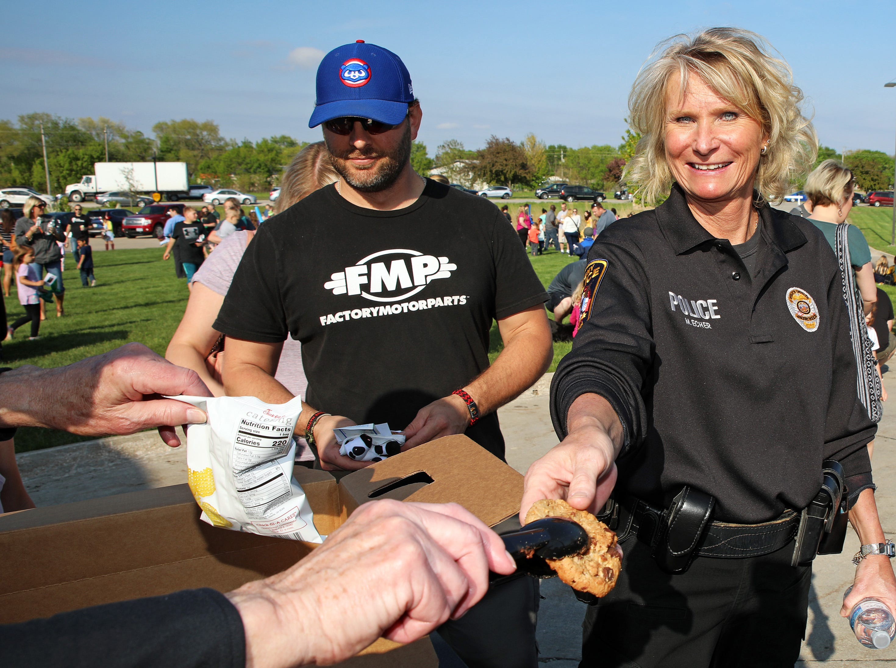 Ankeny Police Captain Makai Echer receives a cookie during the Ankeny Police Week Community Picnic on Tuesday, May 14, 2019 at the Ankeny Police Headquarters located at 411 SW Ordnance Road. The event featured a tour of the police station, magician Jonathon May, free Chick Fil-A sandwiches for the first 1,000 guests, free Kona Ice, temporary tattoos, and a great opportunity to meet the officers who protect and serve the city of Ankeny.