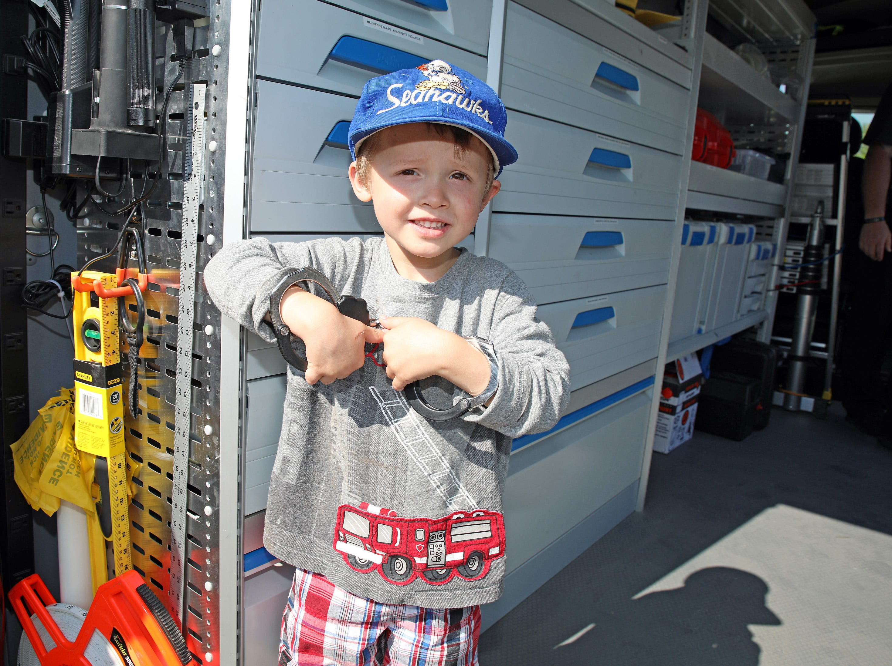 Lincoln Schopf, 3, of Ankeny tries on some handcuffs during the Ankeny Police Week Community Picnic on Tuesday, May 14, 2019 at the Ankeny Police Headquarters located at 411 SW Ordnance Road. The event featured a tour of the police station, magician Jonathon May, free Chick Fil-A sandwiches for the first 1,000 guests, free Kona Ice, temporary tattoos, and a great opportunity to meet the officers who protect and serve the city of Ankeny.