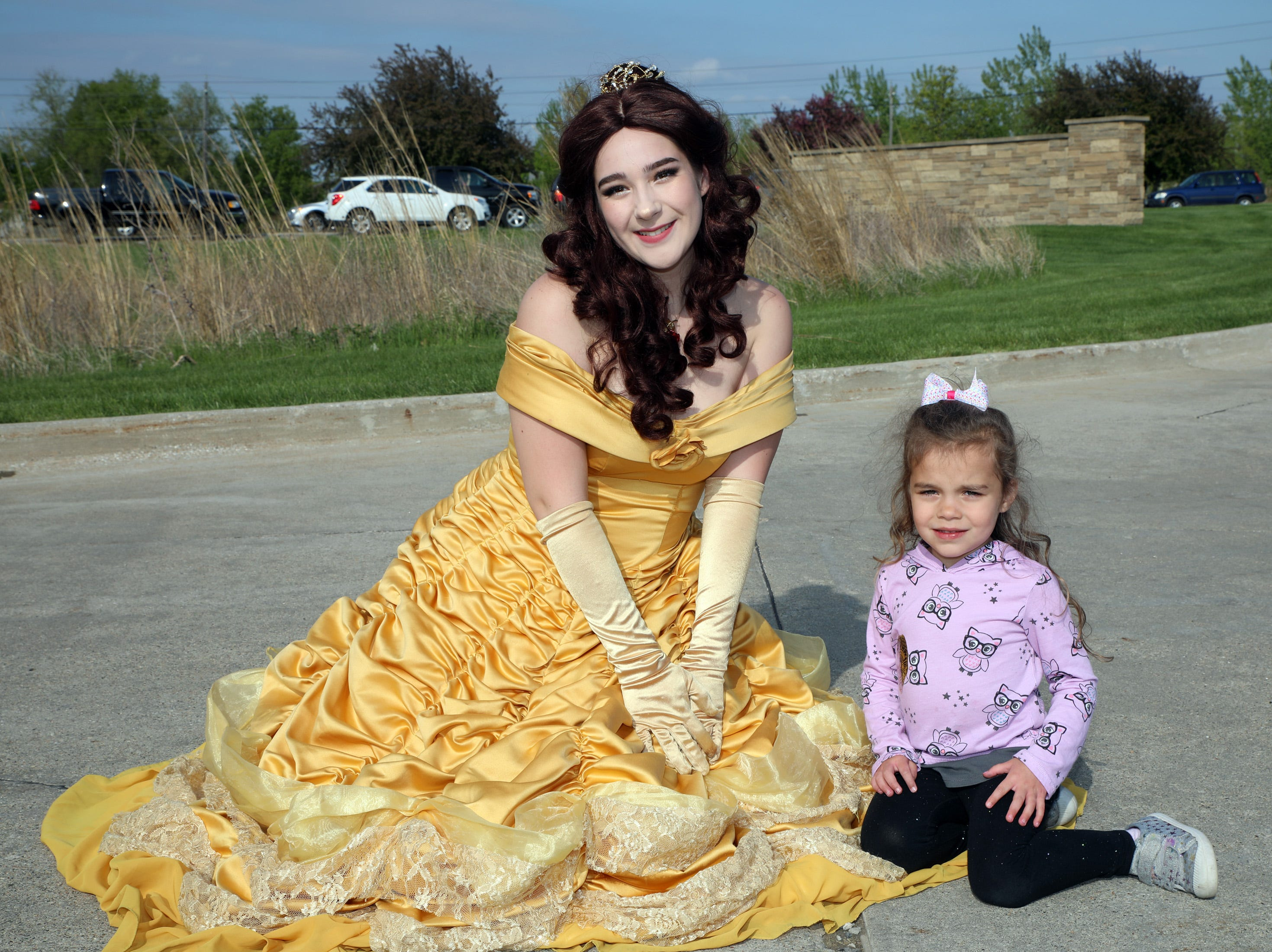 Lilly Marusiak, 3, of Ankeny sits with Belle from Beauty and the Beast at the Ankeny Police Week Community Picnic on Tuesday, May 14, 2019 at the Ankeny Police Headquarters located at 411 SW Ordnance Road. The event featured a tour of the police station, magician Jonathon May, free Chick Fil-A sandwiches for the first 1,000 guests, free Kona Ice, temporary tattoos, and a great opportunity to meet the officers who protect and serve the city of Ankeny.