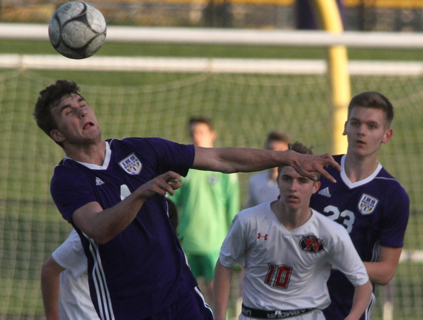 Indianola junior Carter Bussanmas heads the ball. Indianola beat Newton 2-0 at home in a Little Hawkeye Conference game.
