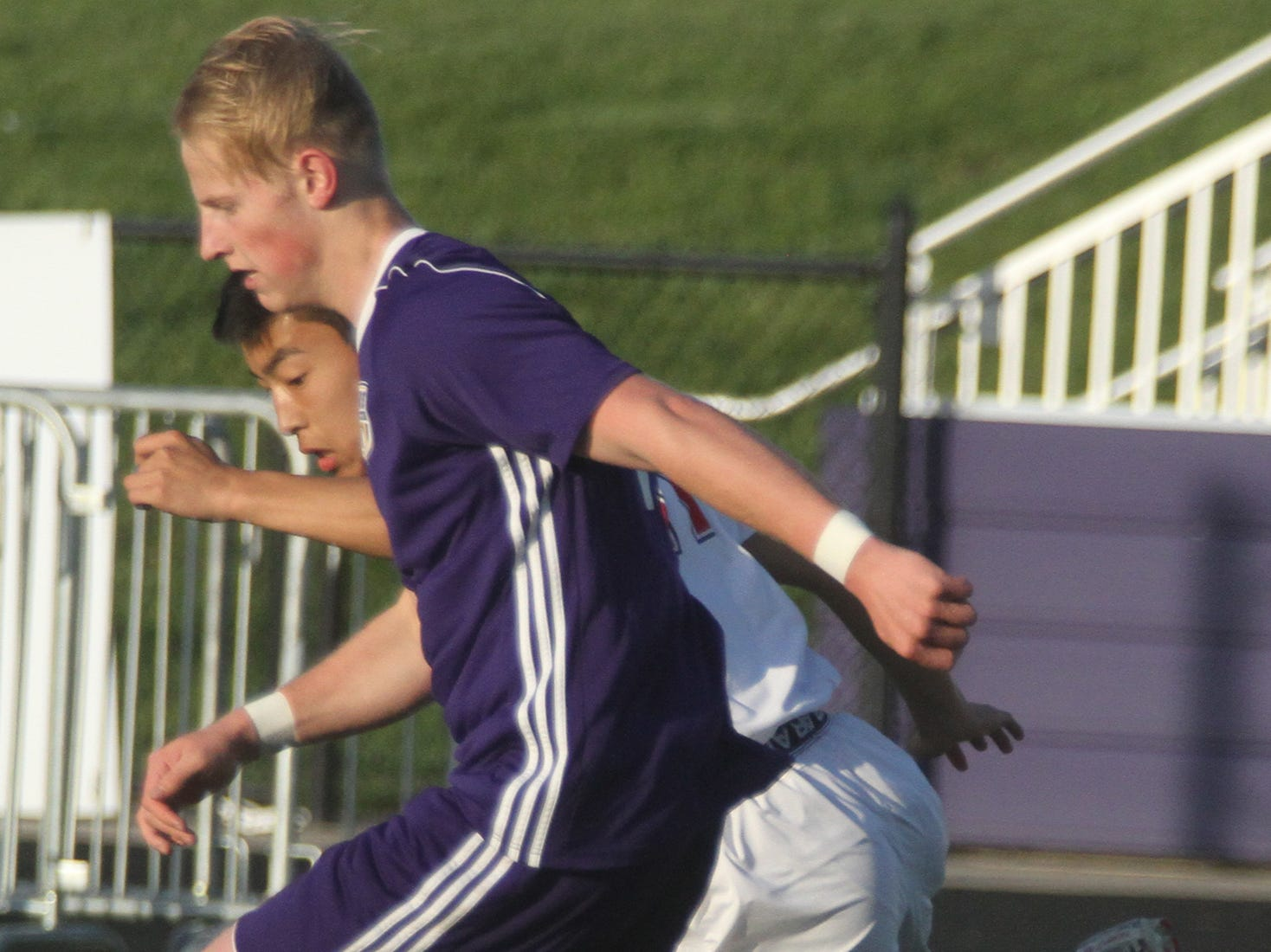 Indianola junior Peyton Boozell tries to get down the field while being defended by Newton junior William Cheng. Indianola beat Newton 2-0 at home in a Little Hawkeye Conference game.